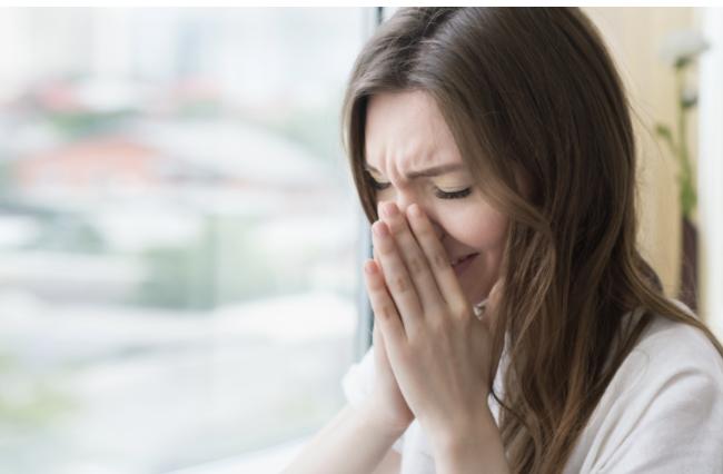 Woman with postpartum depression symptoms.